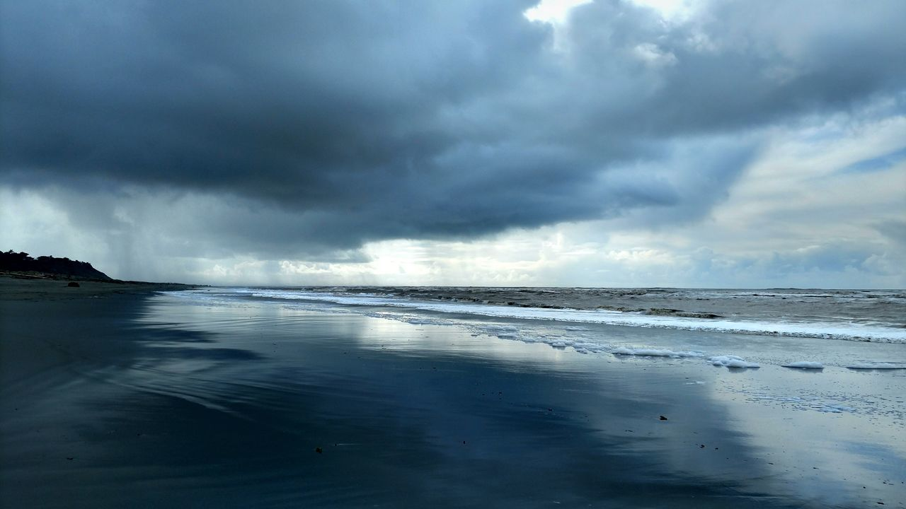 beauty in nature, nature, cloud - sky, water, sky, scenics, weather, tranquility, sea, tranquil scene, no people, outdoors, storm cloud, day, beach, horizon over water, power in nature, wave