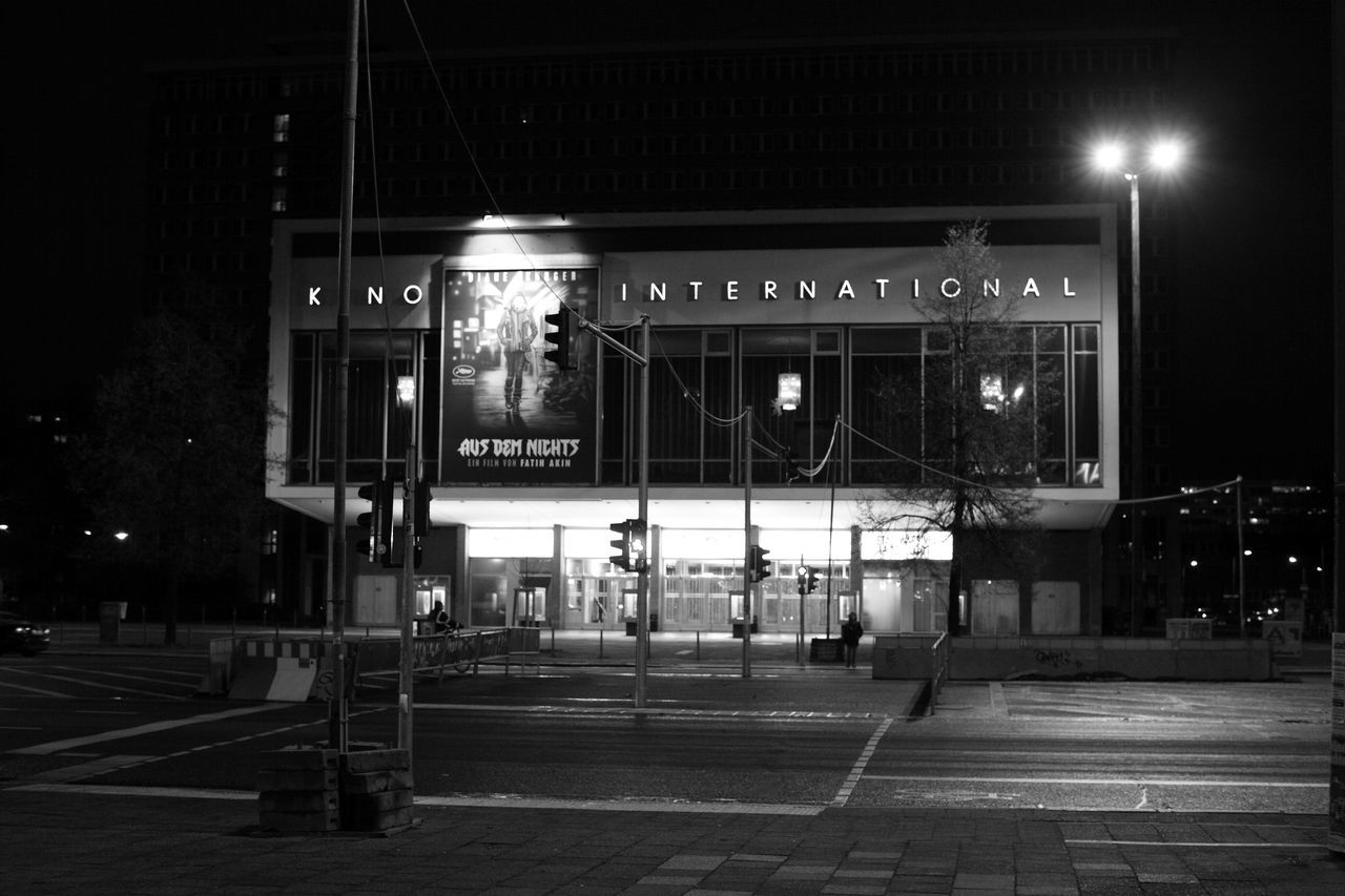 night, illuminated, architecture, transportation, built structure, outdoors, film industry, building exterior, no people