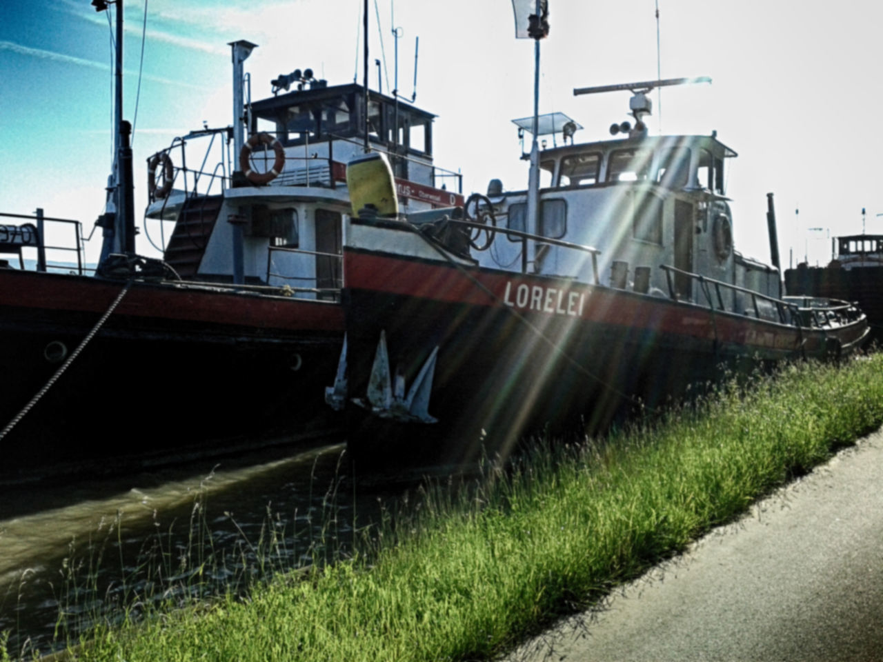 nautical vessel, transportation, outdoors, moored, day, no people, grass, sky
