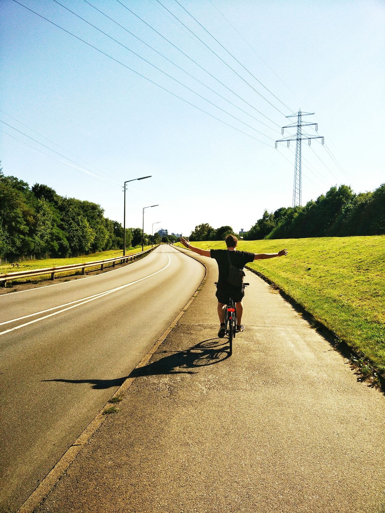 Hamburg Germany Bike Tour Clear Sky Full Length Electricity Pylon Road Shadow Tree Power Line  The Way Forward Blue Day Cable Power Cable Outdoors Diminishing Perspective Casual Clothing Vanishing Point Countryside Sky Person Miles Away