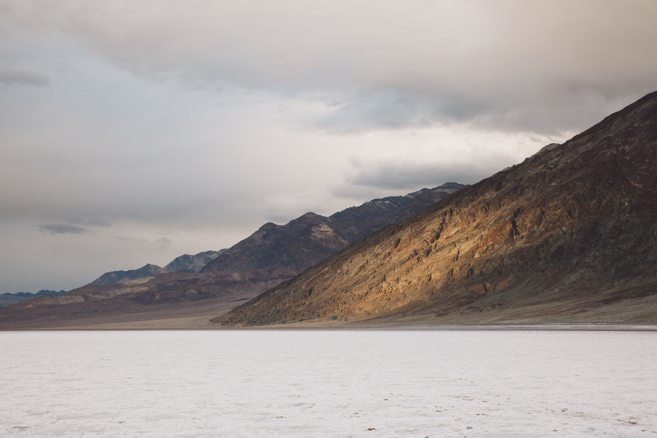 Arid Climate Arid Landscape Bad Water Basin Badwater Basin Beauty In Nature Cloud - Sky Day Death Valley Death Valley National Park Death Valley, California Desert Desert Landscape Landscape Mountain Mountain Range Nature No People Outdoors Salt Scenics Sky Tranquil Scene Tranquility Water