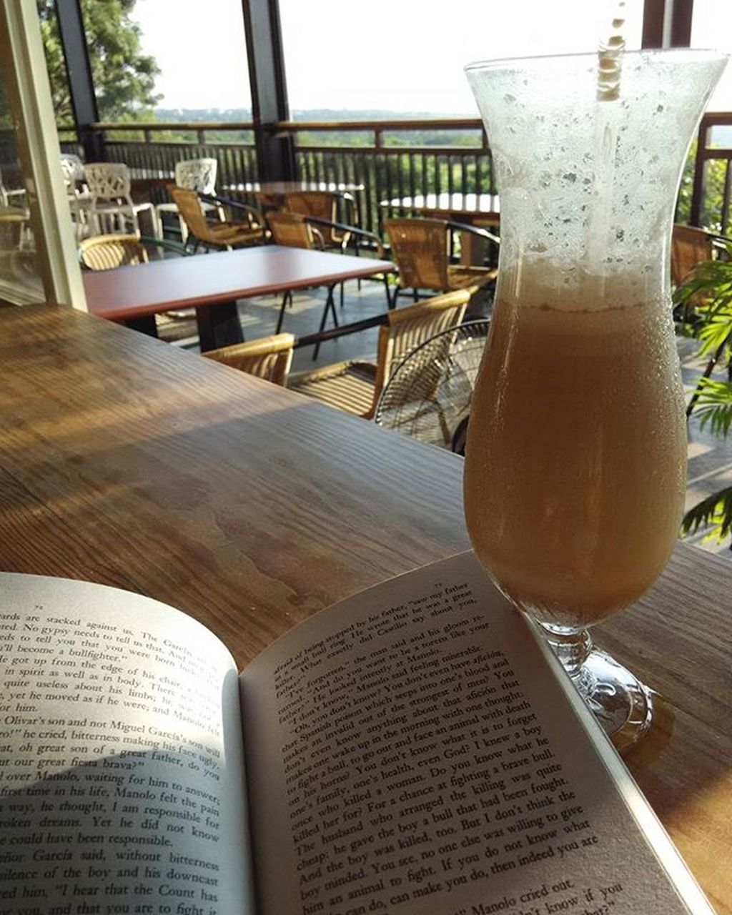 table, drink, book, food and drink, indoors, refreshment, drinking glass, restaurant, no people, cafe, day, close-up, freshness