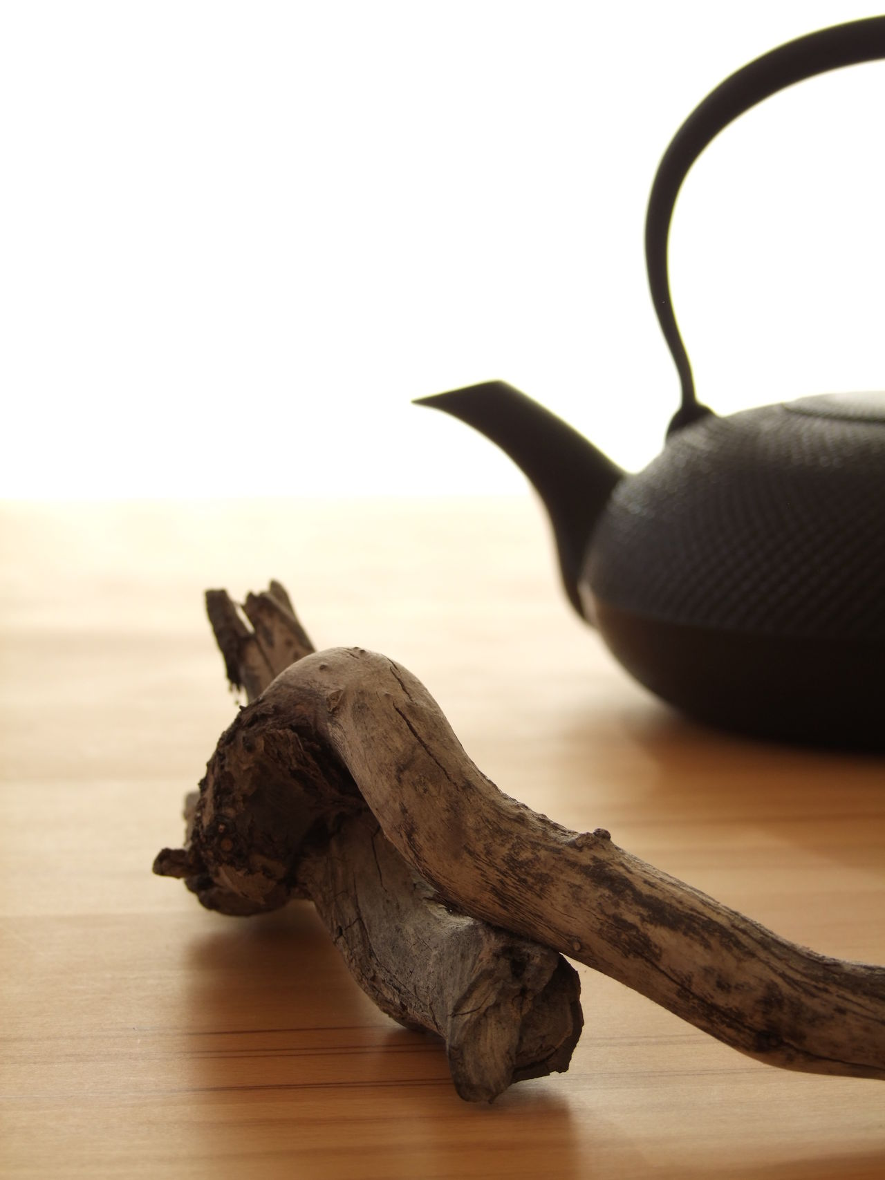 Still life with teapot and wood Beechwood Close-up Day Design Far East Freshness Healthy Eating Hot Drink Japan Japanese  Japanese Culture Japanese Style No People Plain Pot Selective Focus Silhouette Simple Still Life Table Tea Tea Ceremony Tea Time Teapot Wood