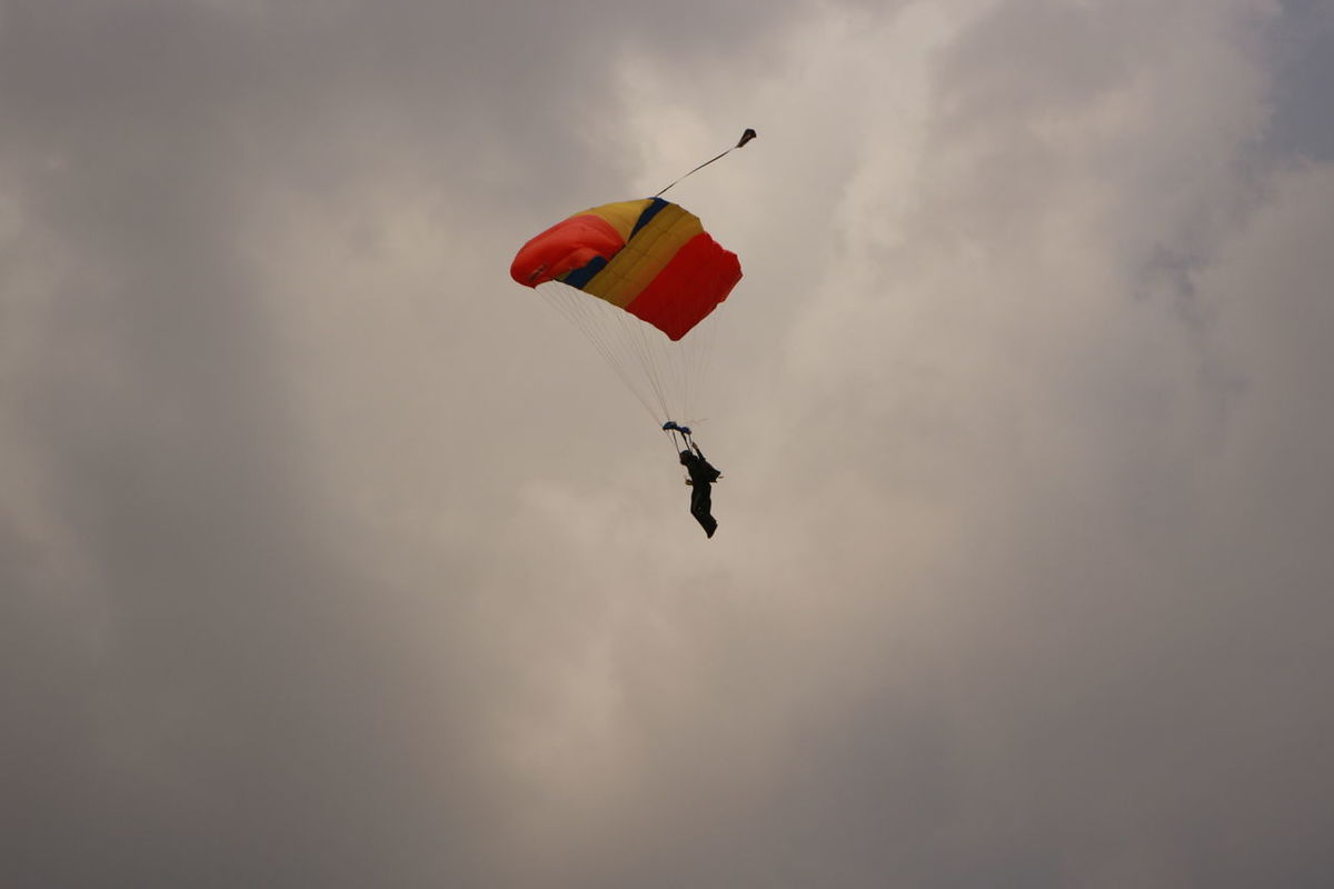 Parachuter descending Adventure Challenge Extreme Sports Flying Fun Gravity Leisure Activity Low Angle View Mid-air Parachute Paragliding Recreational Pursuit RISK Sky Sky Dive Breathing Space