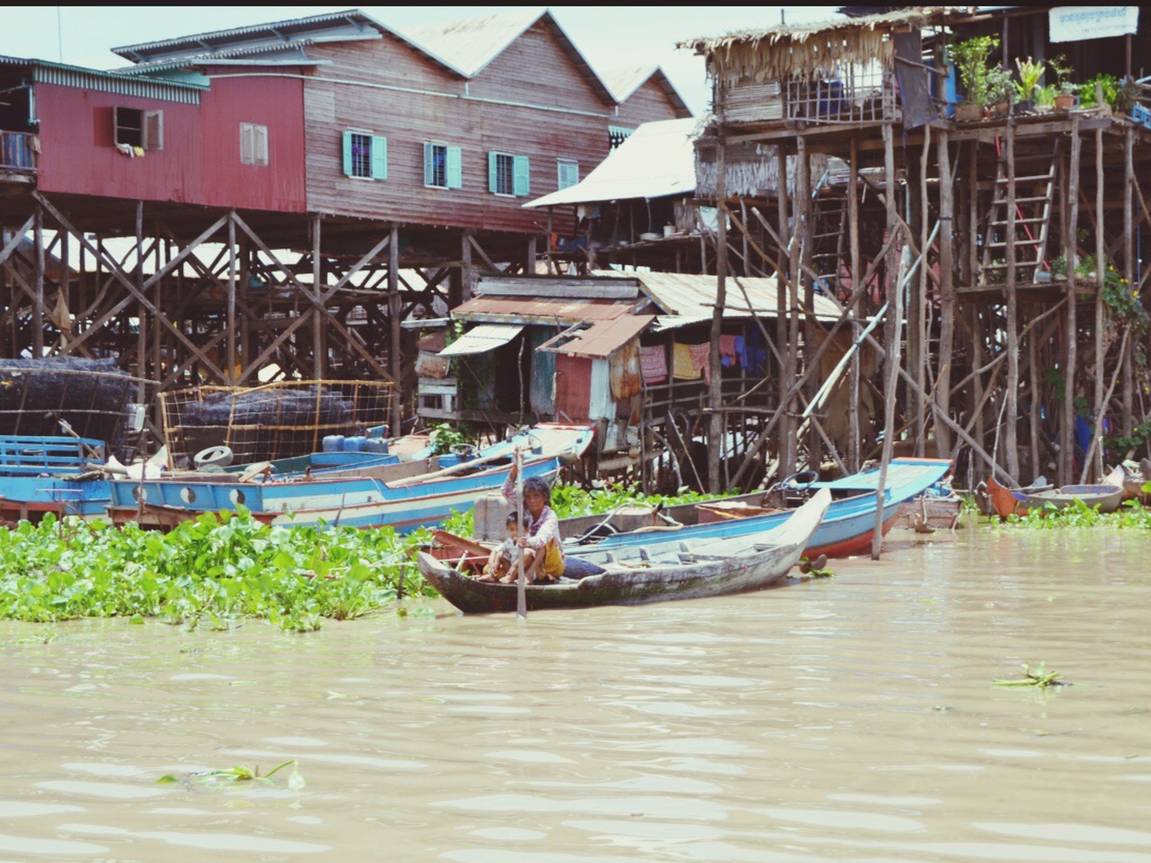 nautical vessel, water, boat, moored, transportation, mode of transport, waterfront, built structure, architecture, building exterior, day, river, outdoors, canal, no people, in a row, nature, rippled, wood - material, lake