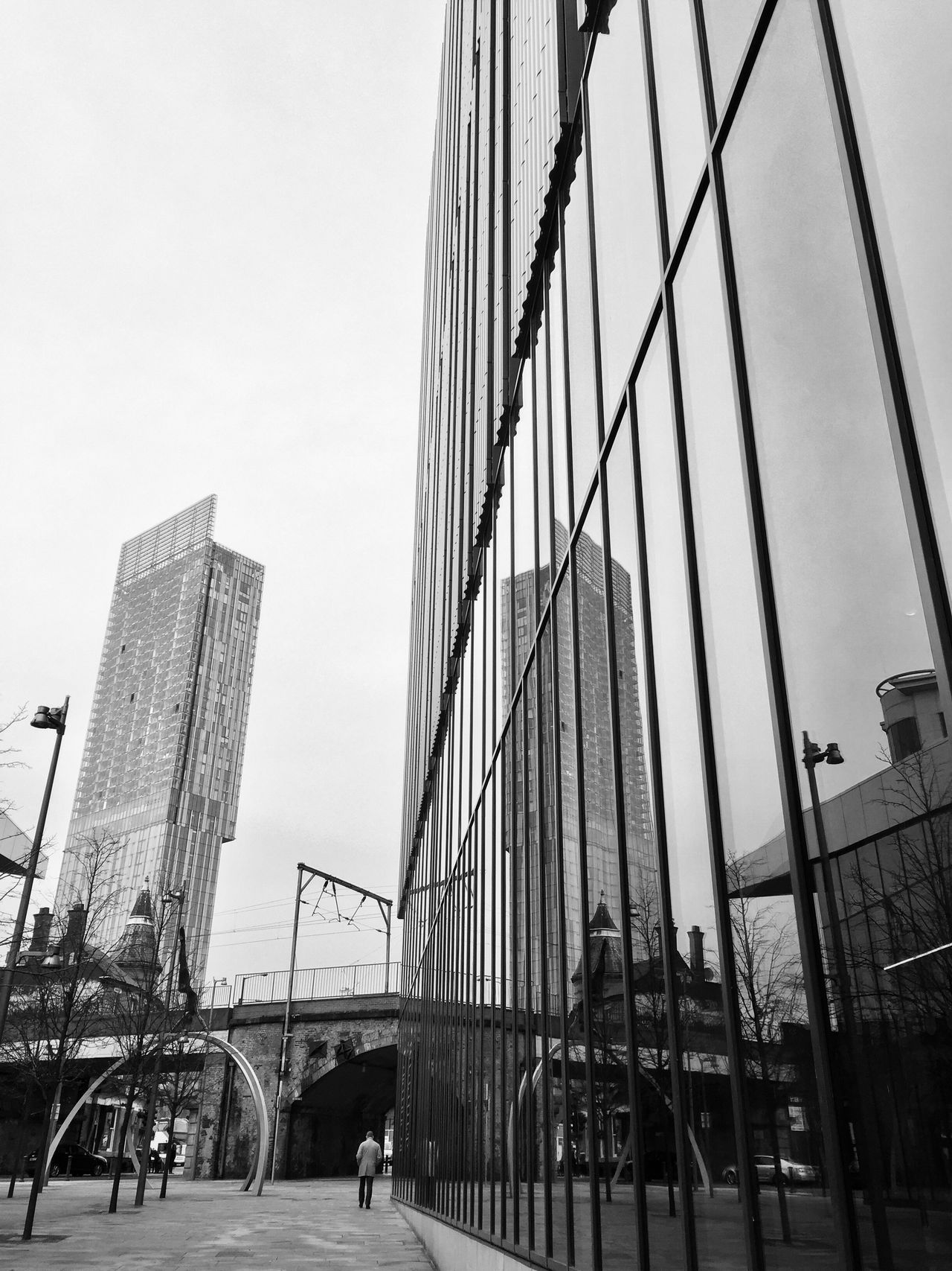 Architectural reflections in the city. Chance Encounters Built Structure Architecture Sky Building Exterior Clear Sky City BeethamTower Getty X EyeEm City Architecture Building Reflections Architecture Cityscape Manchester Outdoors Travel Destinations Real People Men Skyscraper Day People Eye4photography  Streetphoto_bw EyeEm Masterclass Reflections