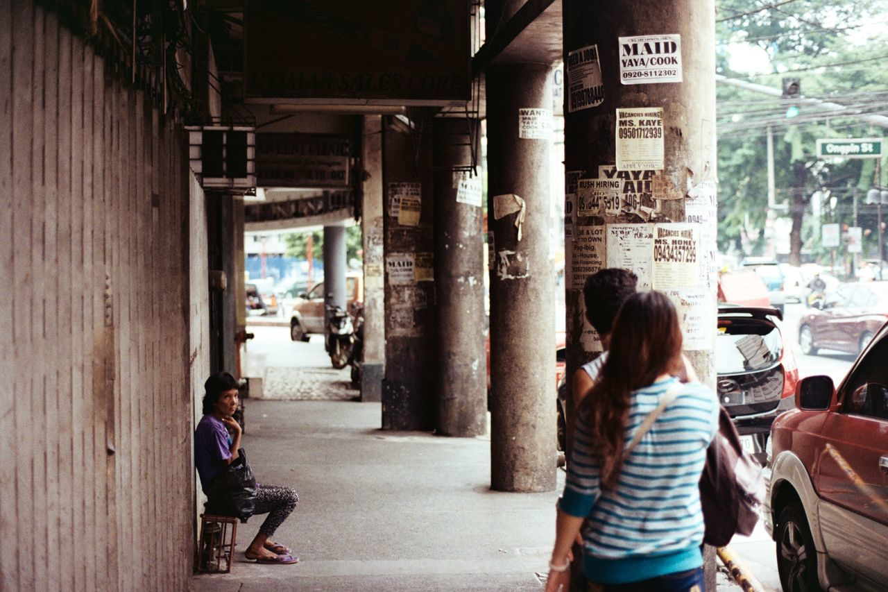 Waiting, watching. Binondo Philippines Streetphotography Street Photography Film Photography 35mm Film Photography Photowalk Real People Unfiltered Unedited City People