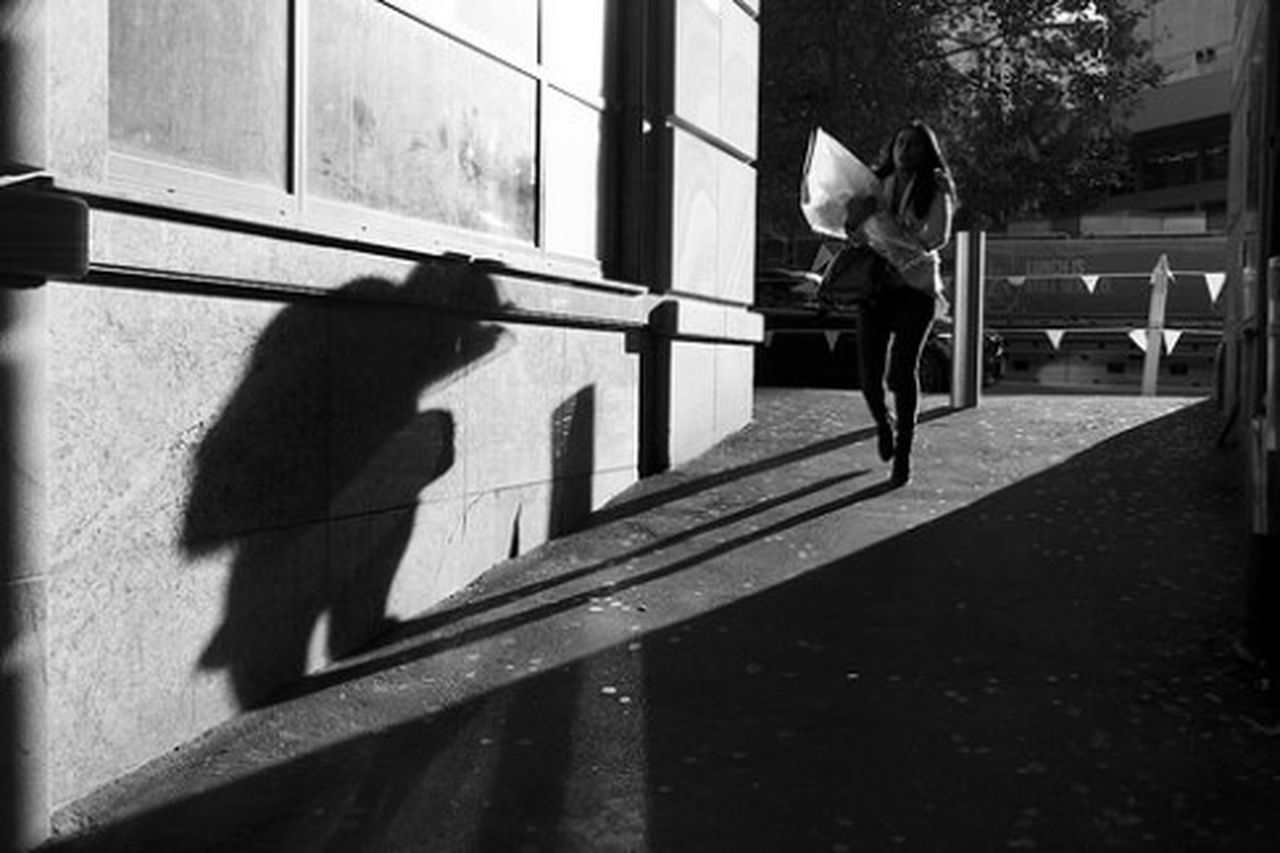 shadow, full length, one person, sunlight, day, people, outdoors, childhood, jumping, adults only, lifestyles, only men, real people, one man only, men, adult, low section, young adult