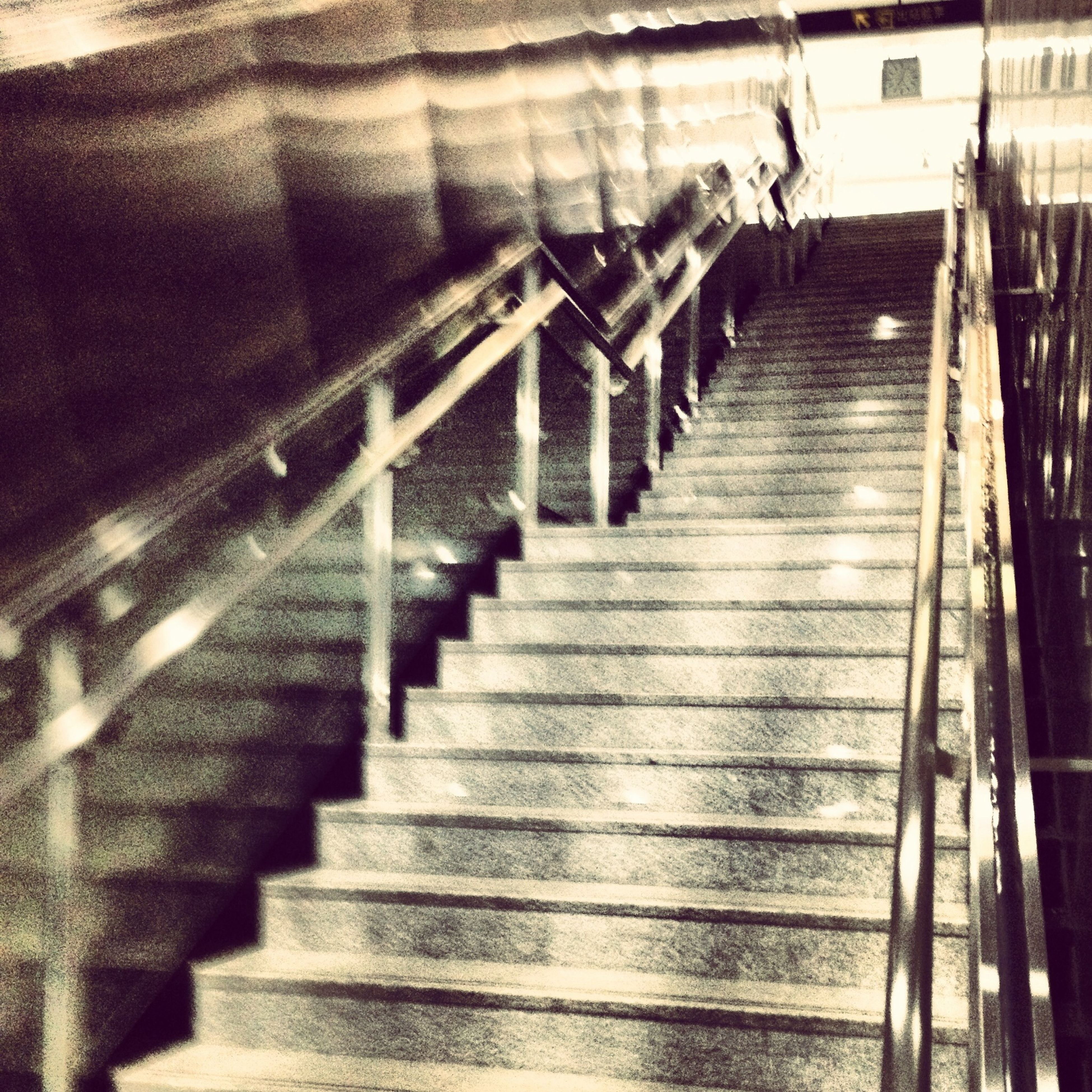 steps and staircases, steps, staircase, railing, the way forward, indoors, high angle view, diminishing perspective, stairs, built structure, moving up, architecture, vanishing point, low angle view, escalator, in a row, metal, narrow, no people, wood - material