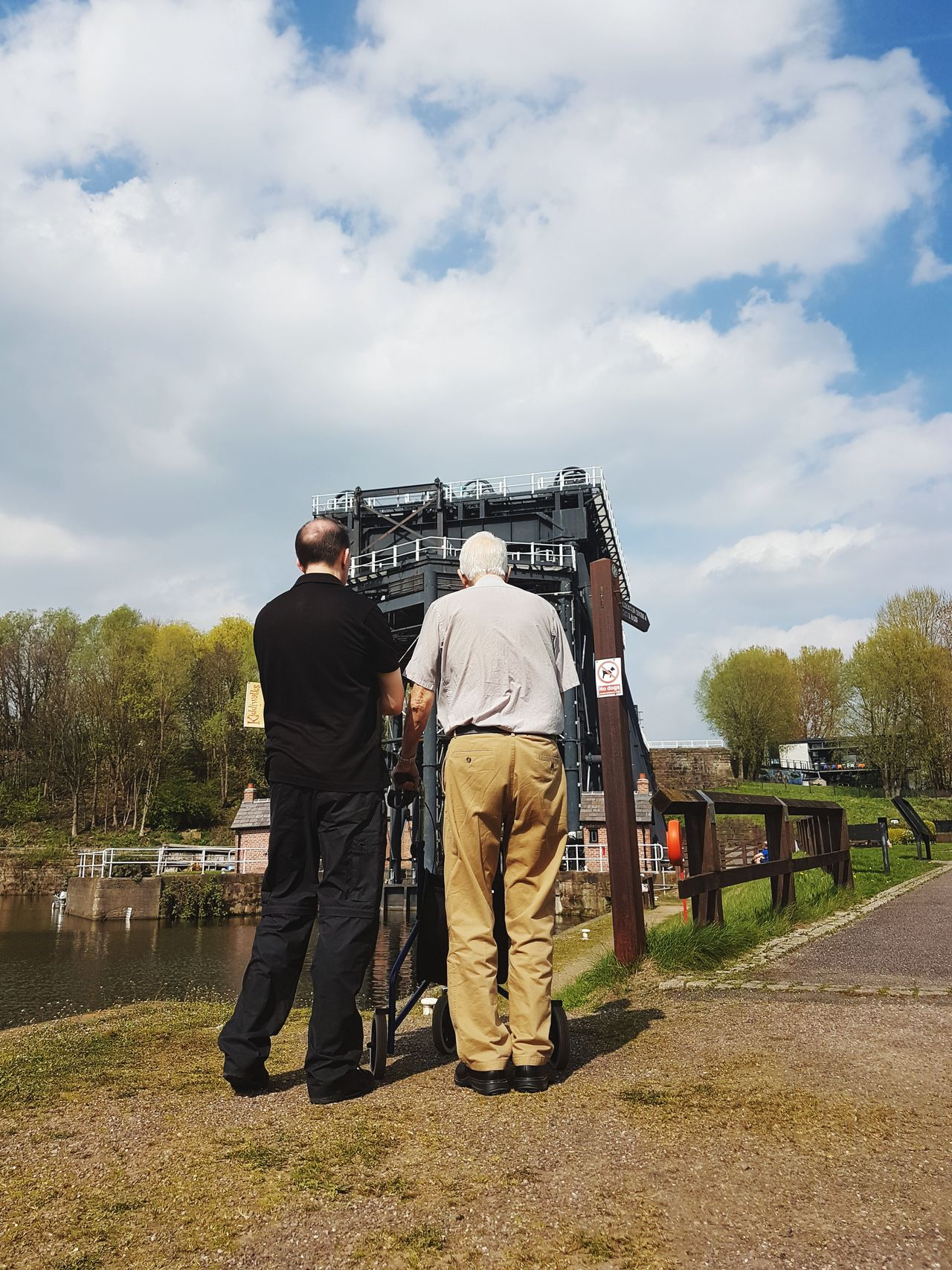 Father & Son Father And Son Rear View Time Together Andertonboatlift Low Angle View Human Body Part Technology Industrial Area Full Length Only Men Senior Adult Men People Blue Water Blue Sky Clouds In The Sky