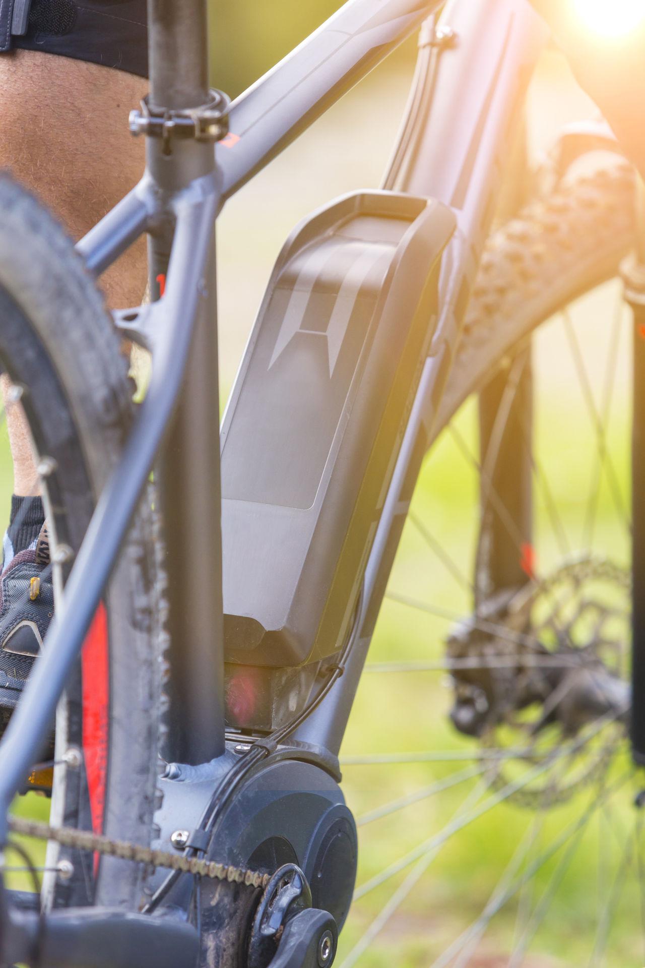 Close up of modern e-mountainbike Battery Bicycle Bike Biker Charge Charging Close-up E-bike E-mountain Ebike Electric Electric Bicycle Electric Bike Fitness Freeride Man Modern Motor Mountainbike Outdoors Power Recreation  Riding Technology Transportation