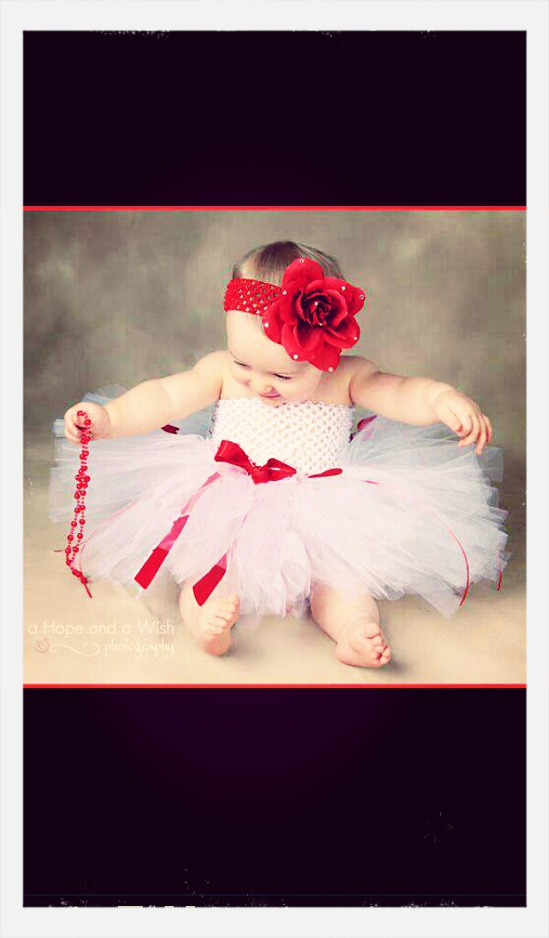 transfer print, auto post production filter, indoors, animal representation, pink color, childhood, creativity, person, holding, close-up, art, toy, high angle view, red, art and craft, lifestyles, full length, day