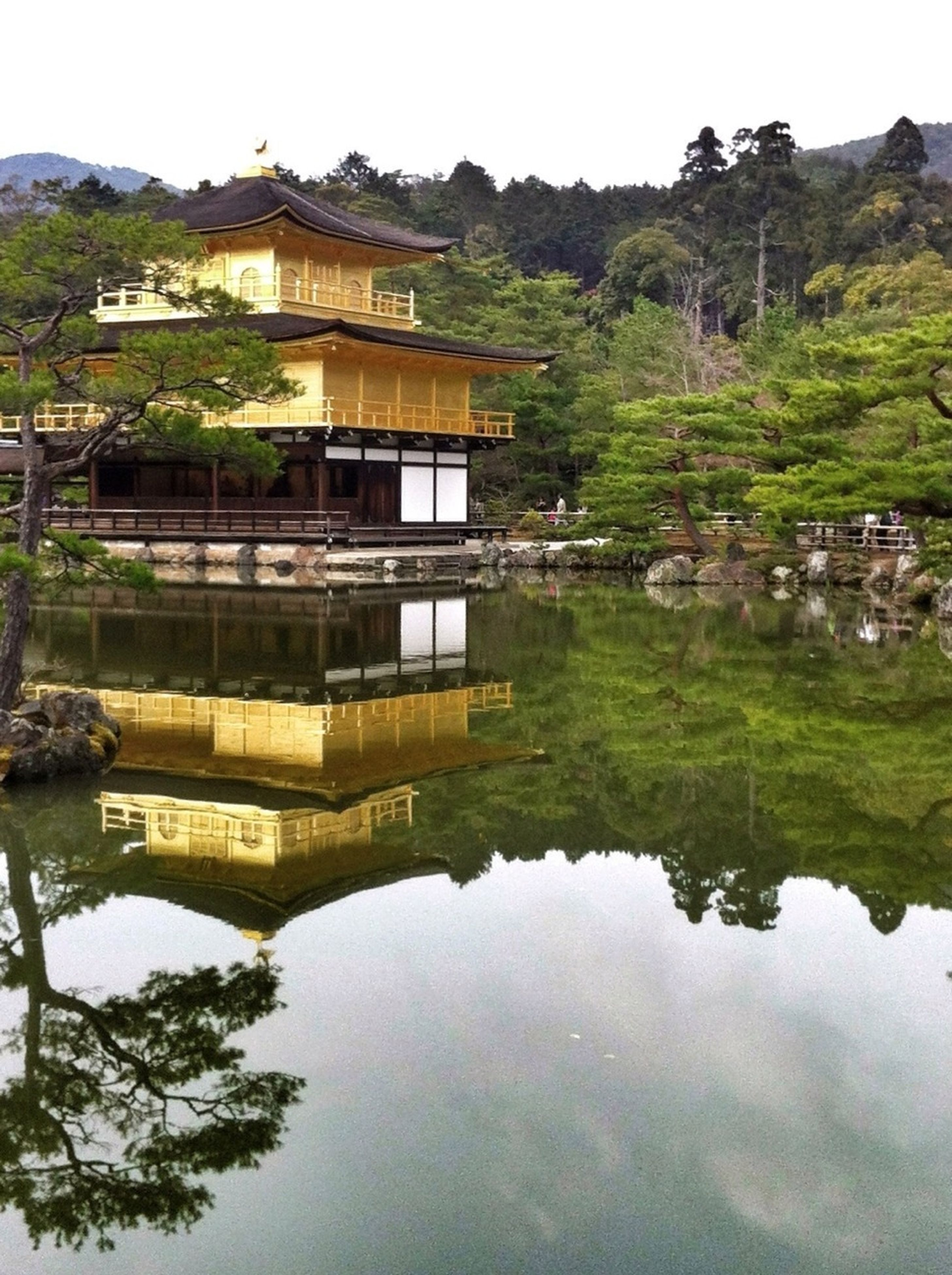 reflection, architecture, water, built structure, building exterior, tree, house, waterfront, standing water, lake, tranquility, clear sky, tranquil scene, nature, mountain, sky, scenics, day, river, residential structure