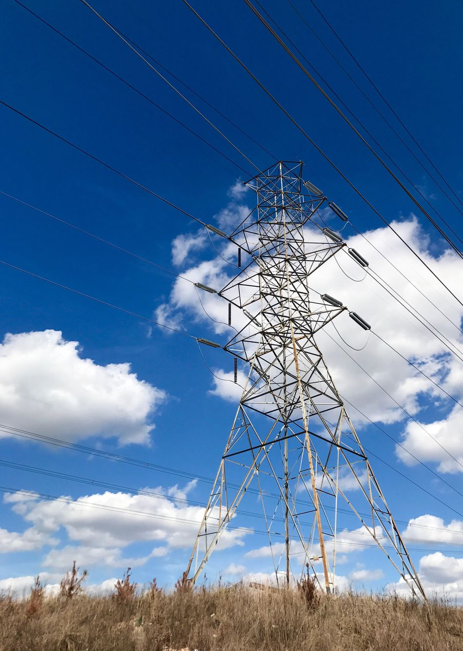 Cable Electricity  Electricity Pylon Power Supply Fuel And Power Generation Sky Power Line  Connection Low Angle View Field Cloud - Sky No People Outdoors Day Electricity Tower Technology Electricity Wires Electric Wire Electric Tower