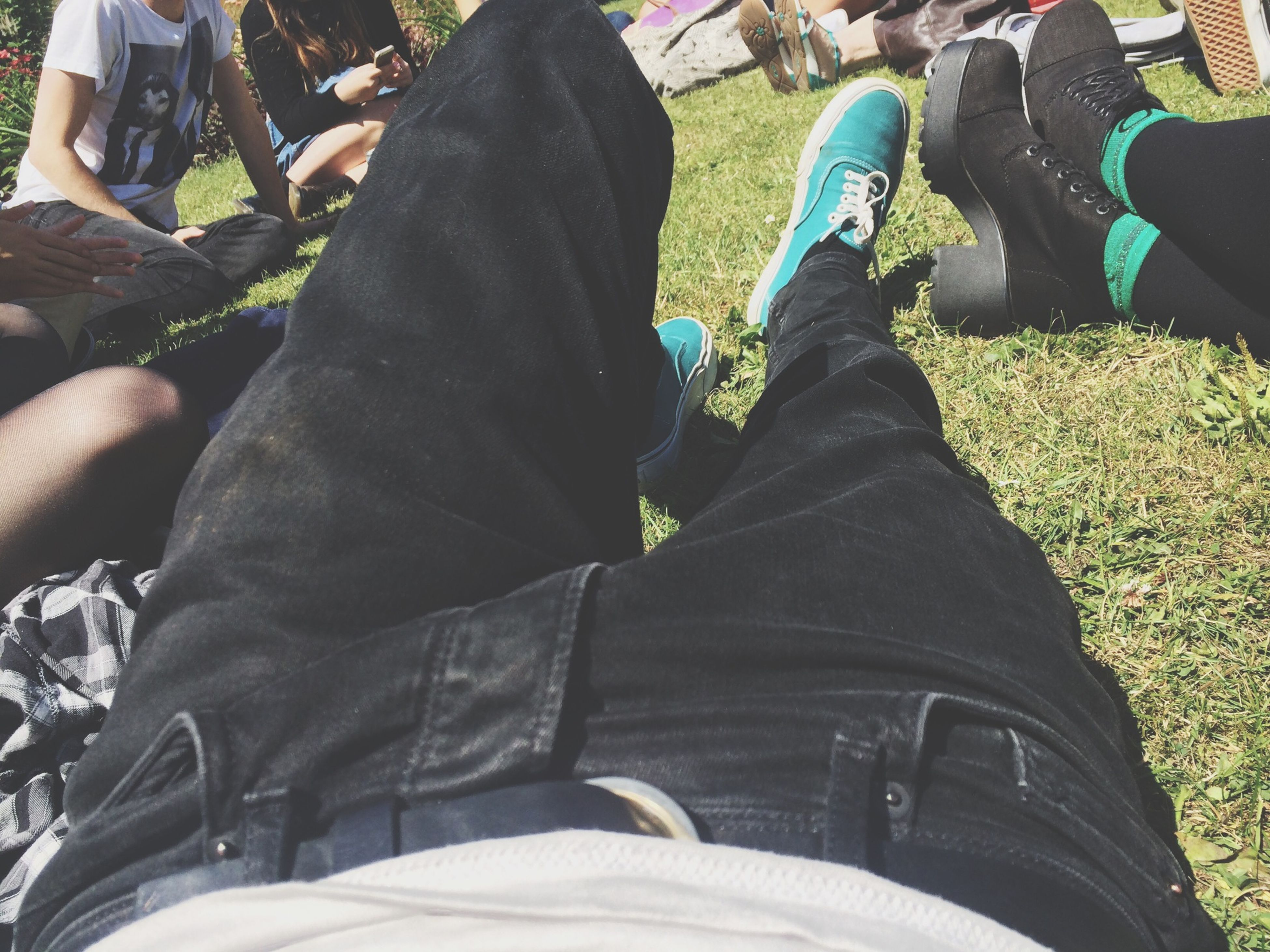 low section, men, person, lifestyles, leisure activity, shoe, sitting, togetherness, casual clothing, human foot, standing, jeans, bonding, personal perspective, high angle view