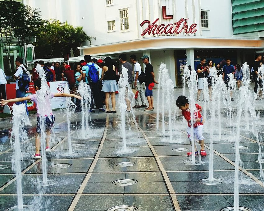 Siblings Having Fun Kids Being Kids Fountain Water Streetphotography Capitol Piazza Singapore