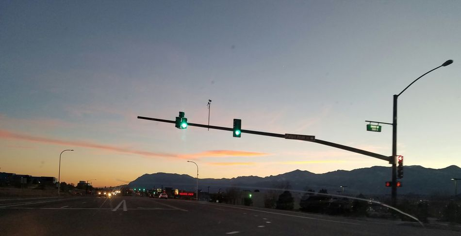 In My Own Lane Mountains And Sky Sunset Outdoors Dramatic Sky No People Green Light Traffic Signals My Point Of View Through My Windshield Through The Glass Photo Therapy Mountain Life Night Shot Night Photography Orange Sky Sunset Beautyeverywhere Mountain_collection Beautiful Scenery Blue Sky Happy Place Yellow Sky, Sunset. Drive Home Skemp Intersection Views