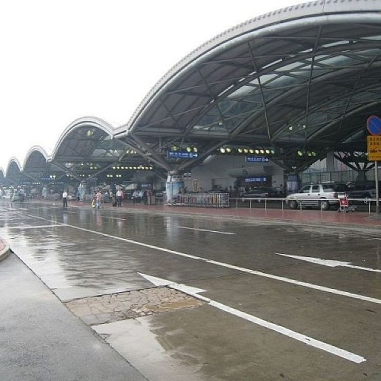 Kolkata Airport Newly Renovated . Pic taken by my dad while he was waiting to pick me up. Kolkata Airport New Rain Bengal West Evening Car Parkinglot Lone
