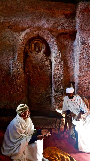 Lalibela, Ethiopia Architecture Built Structure Day Ethiopia Full Length Heritage Heritage Building Indoors  Lalibela Lifestyles Men Monks Place Of Worship Priest Religion Religion And Beliefs Spirituality Tradition Two People Unesco World Heritage