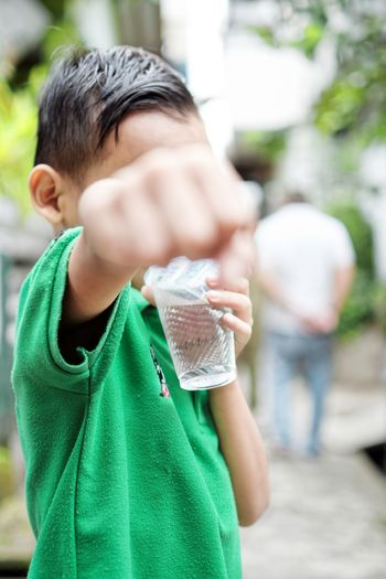 Superman can be thirsty too ... Bandung Shooter Indonesian Shooter Boys Casual Clothing Child Childhood Close-up Day Father Focus On Foreground Green Color Leisure Activity Lifestyles Outdoors People Real People Son