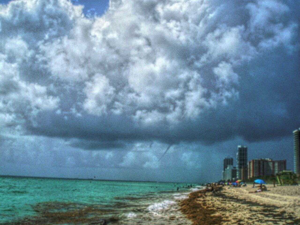 sea, sky, beach, horizon over water, cloud - sky, water, nature, outdoors, sand, day, scenics, tranquility, architecture, no people, beauty in nature, storm cloud, building exterior, city