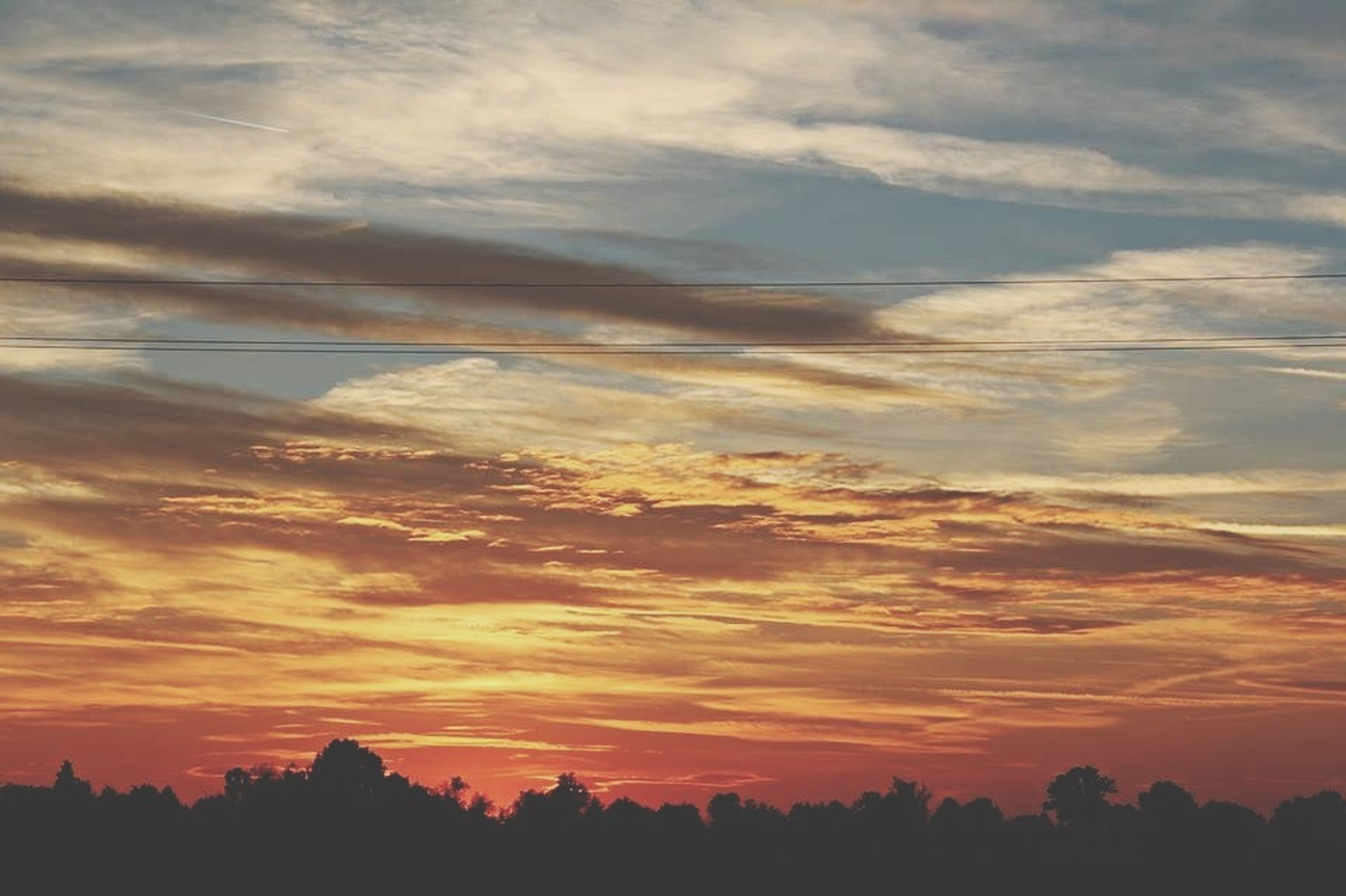 sunset, sky, scenics, tranquil scene, silhouette, tranquility, beauty in nature, cloud - sky, nature, tree, idyllic, cloud, orange color, landscape, majestic, cloudy, dramatic sky, outdoors, no people, non-urban scene