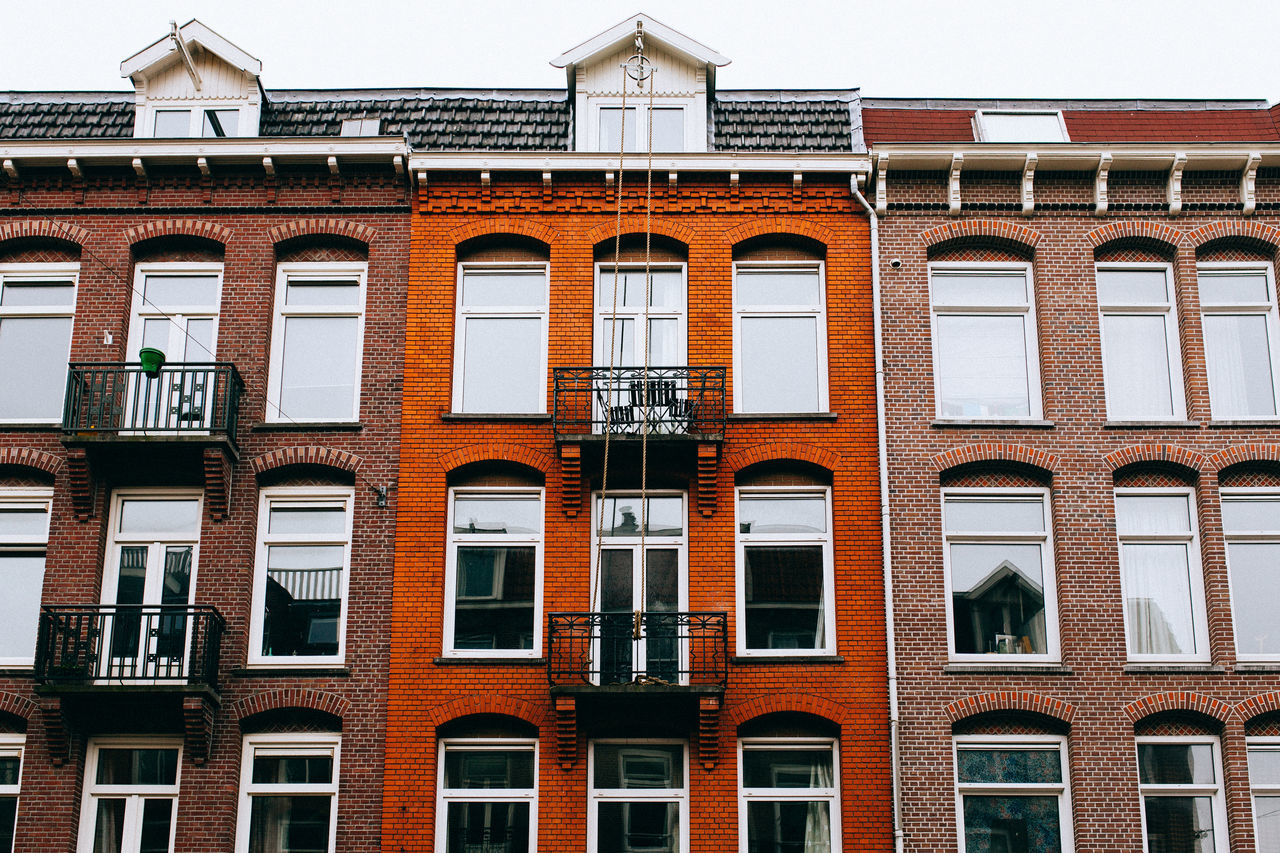 A Wintery Amsterdam... All Streets Amsterdam Architecture Balcony Building Building Exterior Built Structure City Clear Sky Day Exterior Façade In A Row Low Angle View No People Outdoors Repetition Residential Building Residential Structure Side By Side Sky Window Your Amsterdam EyeEm X Google - Your Amsterdam