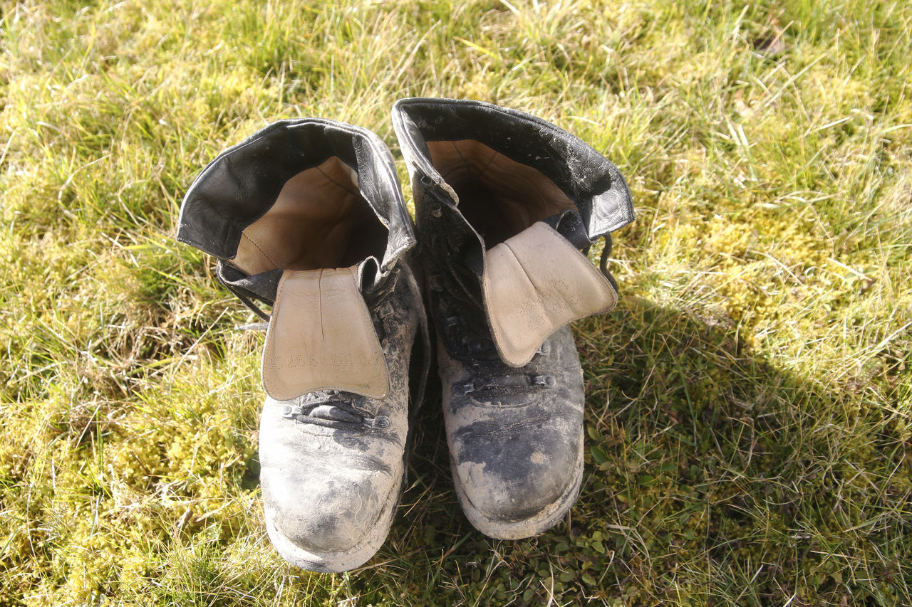 Old shoes Day Field Grass Human Body Part Human Leg Low Section Men Nature Old Shoes One Person Outdoors Pair Shoes