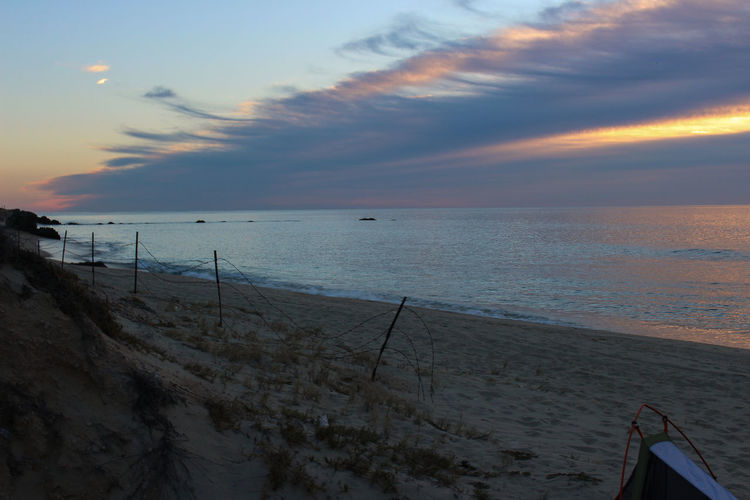 Beach Life Camping Colorful Sunrise Colors Ocean View Beach Beach Camping Beach Fence Beachphotography Colorful Sky Fence On Beach Nature Ocean Ocean Sunrise Scenics Sea Sky Still Water Sunrise Sunrise And Clouds Sunrise Over Water Sunset Tranquil Scene Tranquility Water