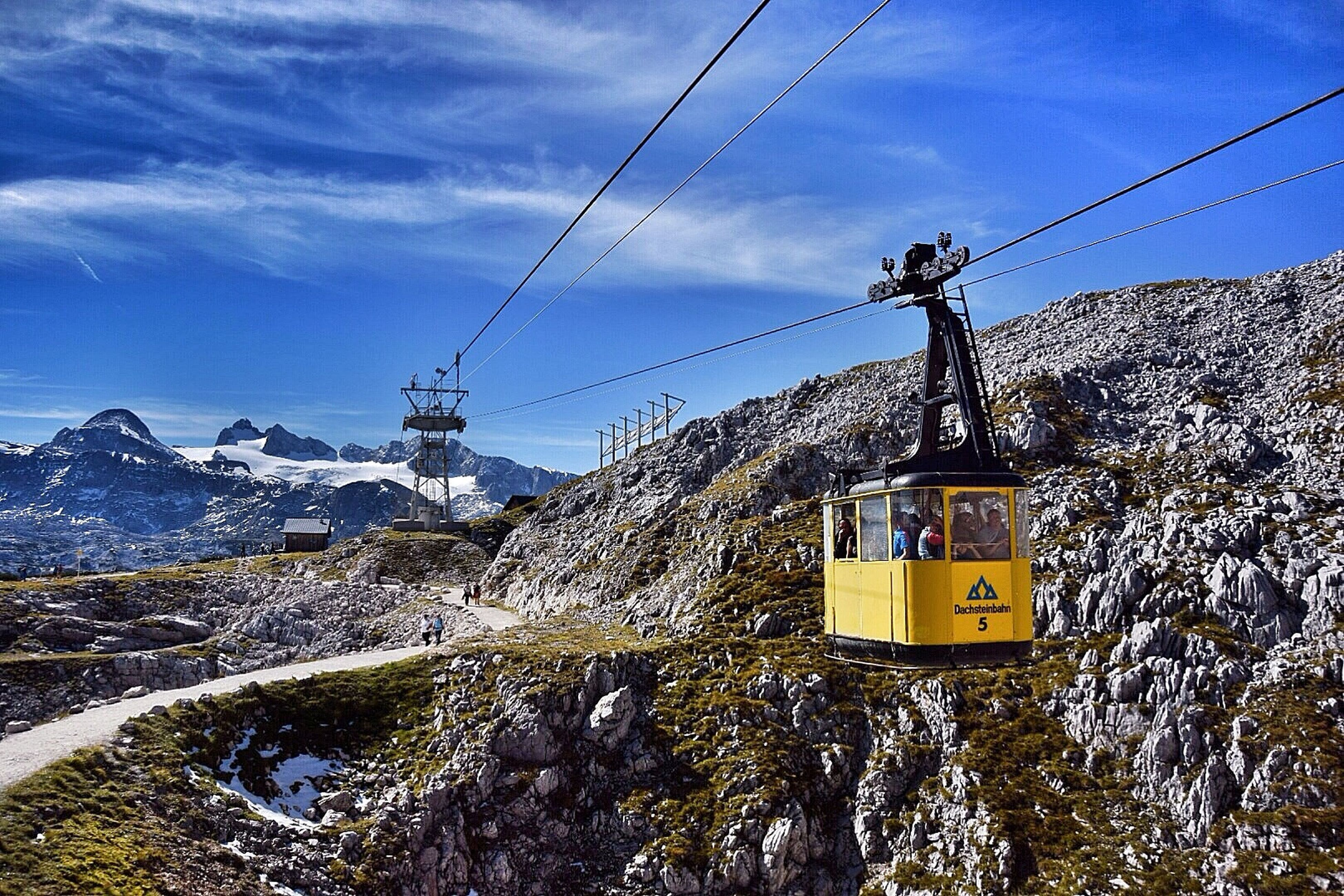 snow, cold temperature, winter, mountain, sky, power line, cable, season, overhead cable car, nature, tranquility, electricity, cloud - sky, weather, electricity pylon, beauty in nature, tranquil scene, scenics, mountain range, snowcapped mountain
