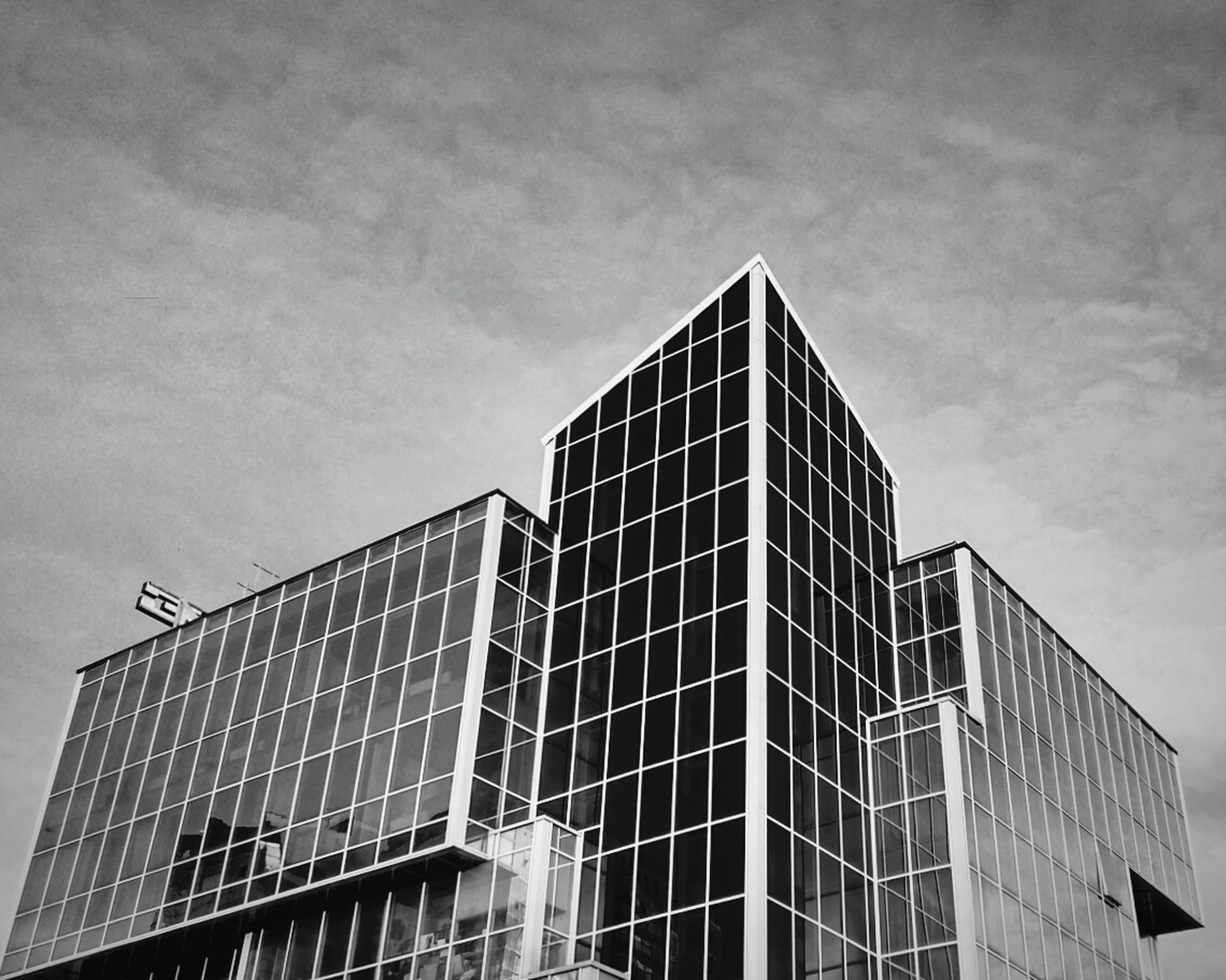 architecture, built structure, low angle view, building exterior, sky, building, modern, office building, city, window, cloud - sky, tall - high, day, outdoors, no people, glass - material, tower, skyscraper, cloud, cloudy