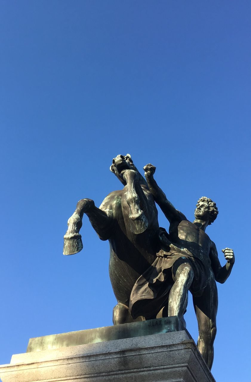 statue, sculpture, human representation, low angle view, art and craft, male likeness, clear sky, no people, outdoors, day, history, blue, architecture, sky