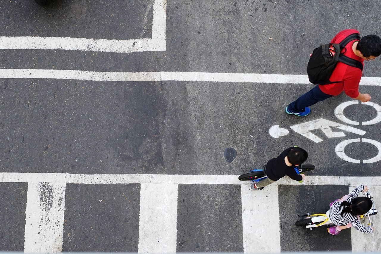 High Angle View Directly Above Transportation Streetphotography Street Signs Urban Lifestyle Flying High Asphalt Leisure Activity Outdoors On Your Bike Low Section Cityscape Starting Line On The Road