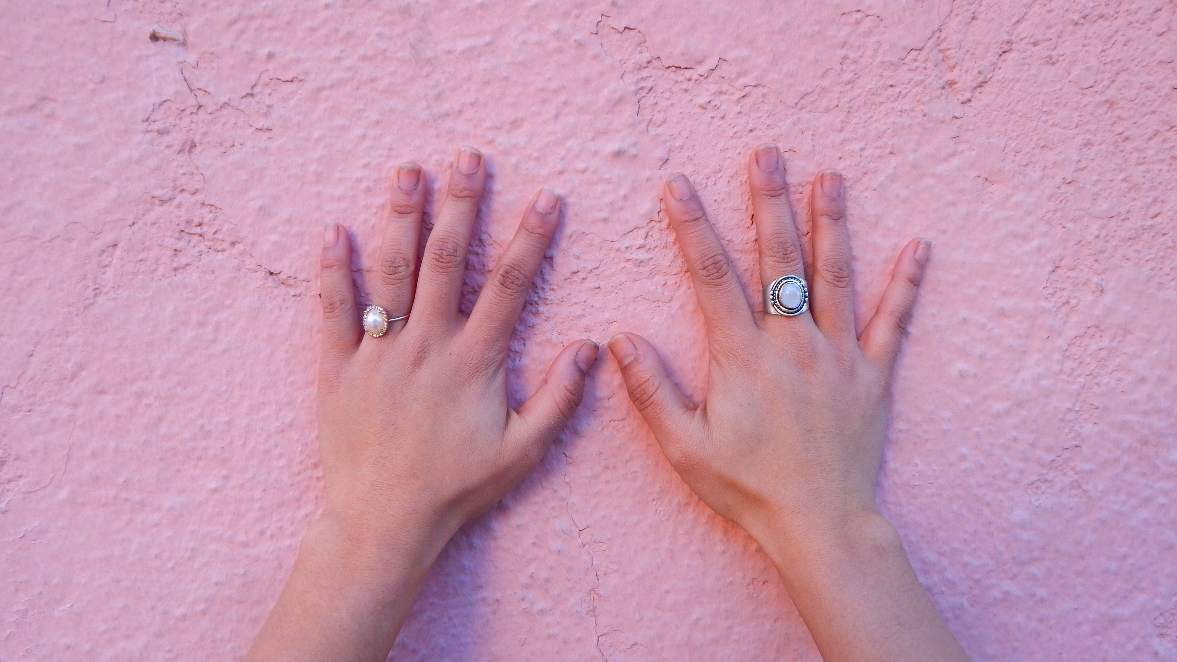 person, part of, close-up, indoors, human finger, lifestyles, personal perspective, unrecognizable person, wall - building feature, cropped, leisure activity, high angle view, holding, nail polish, human skin, creativity