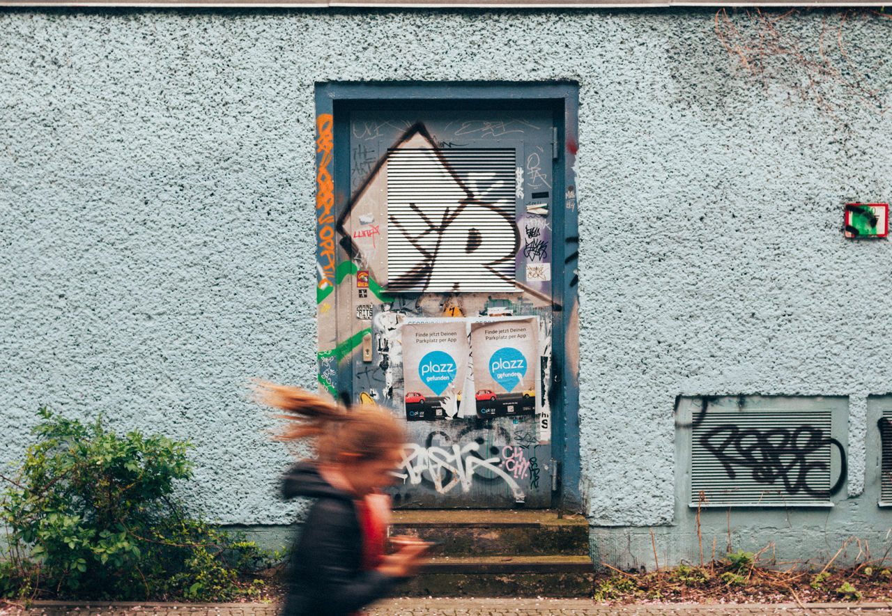 Run to daddy. Architecture Berlin Berlin Photography Berliner Ansichten Blurred Motion Building Exterior Built Structure Child Clock Day Door Girl Graffiti Lifestyles Long Hair Motion One Person Outdoors People Prenzlauerberg Real People Run Running Streetphotography Symmetry