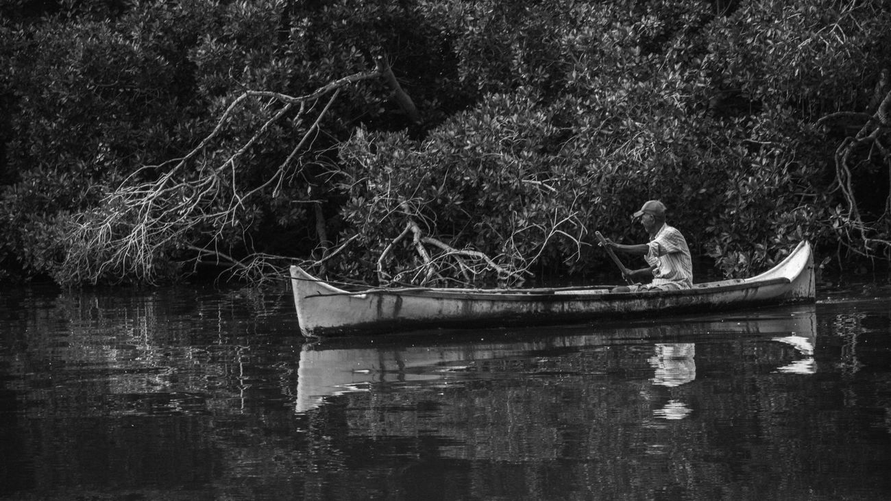 Fisherman - San Antero, Cordoba Beauty In Nature Boat Colombia Fisherman One Person Outdoors People Real People Rowboat Rowing Transportation Water