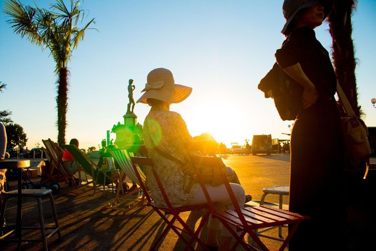Randomasians Sunset Sunlight Leisure Activity Real People Sitting Chair Relaxation Outdoors Togetherness People Adult Men Young Adult Water Day Sky Adults Only