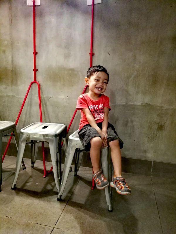 Childhood Child Sitting Chair Wall Wall Decoration Happiness Happykiddo Red Shirts Of EyeEm Red Shirt Photography Smile Smiling Eyes Smiling Child