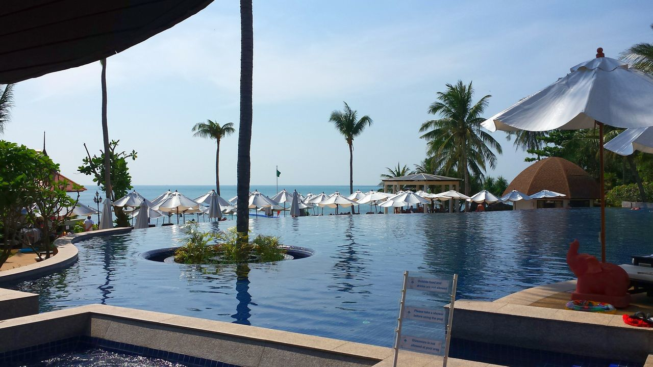 Thailand Koh Lanta Hotel Pool Tropical Paradise The Best From Holiday POV Water Reflections Blue Water Crystal Clear WatersLooks So Inviting Blue Sky Shades Of Blue Blue Sea White Album Sunshades Coconut Trees Beliebte Fotos Popular Photos