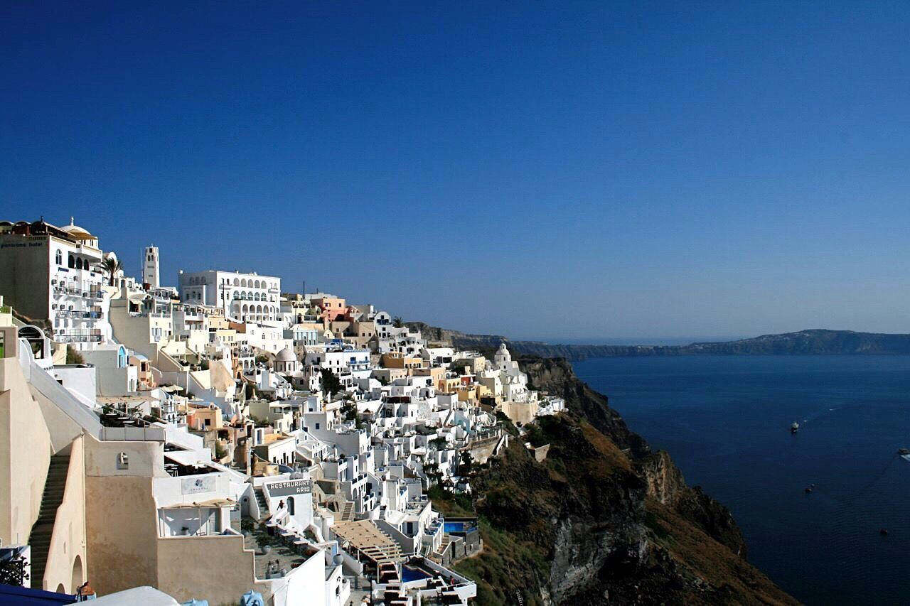 Fira, Santorini Copy Space Clear Sky Blue Building Exterior Architecture Sea Built Structure Outdoors Water City Residential Building Cityscape Nature Day Scenics Beauty In Nature Sky No People Canonphotography Santorini, Greece Canon400d City Rock Formation