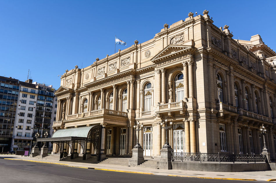 Buenos Aires, Argentina - October 29, 2016: Facade of the Teatro Colon in Buenos Aires and traffic in the street America Architecture Argentina Argentine Buenos Aires Building Capital Cars Ciudad Autónoma De Buenos Aires Colon Columbus Columbus Theatre Landmark Metropolis NeoClassicism Opera House Opéra Sightseeing Street Theater Theatre Tourism Traffic Urban Venue