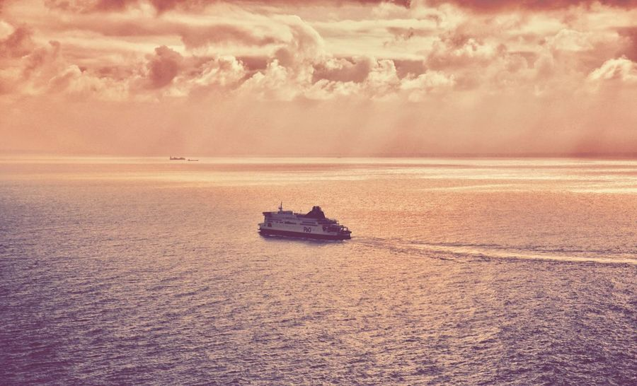 Ferry to France Nautical Vessel Boat Sea Tranquil Scene Transportation Water Waterfront Scenics Mode Of Transport Tranquility Calm Sunset Beauty In Nature Ocean Cloud Nature Cloud - Sky Outdoors Day Seascape