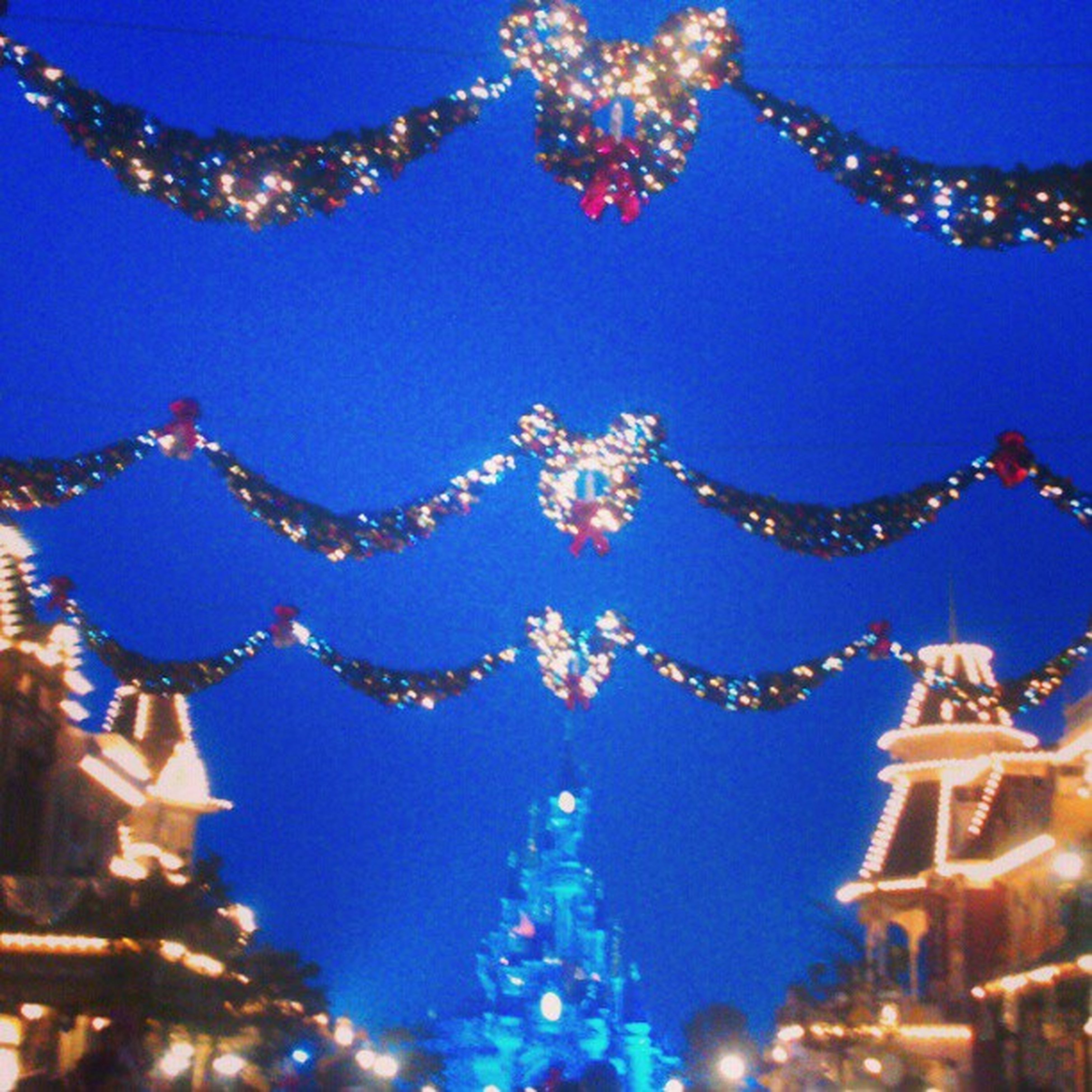 illuminated, decoration, blue, low angle view, architecture, clear sky, night, built structure, travel destinations, celebration, famous place, christmas decoration, building exterior, christmas, tradition, christmas tree, christmas lights, international landmark, hanging, capital cities