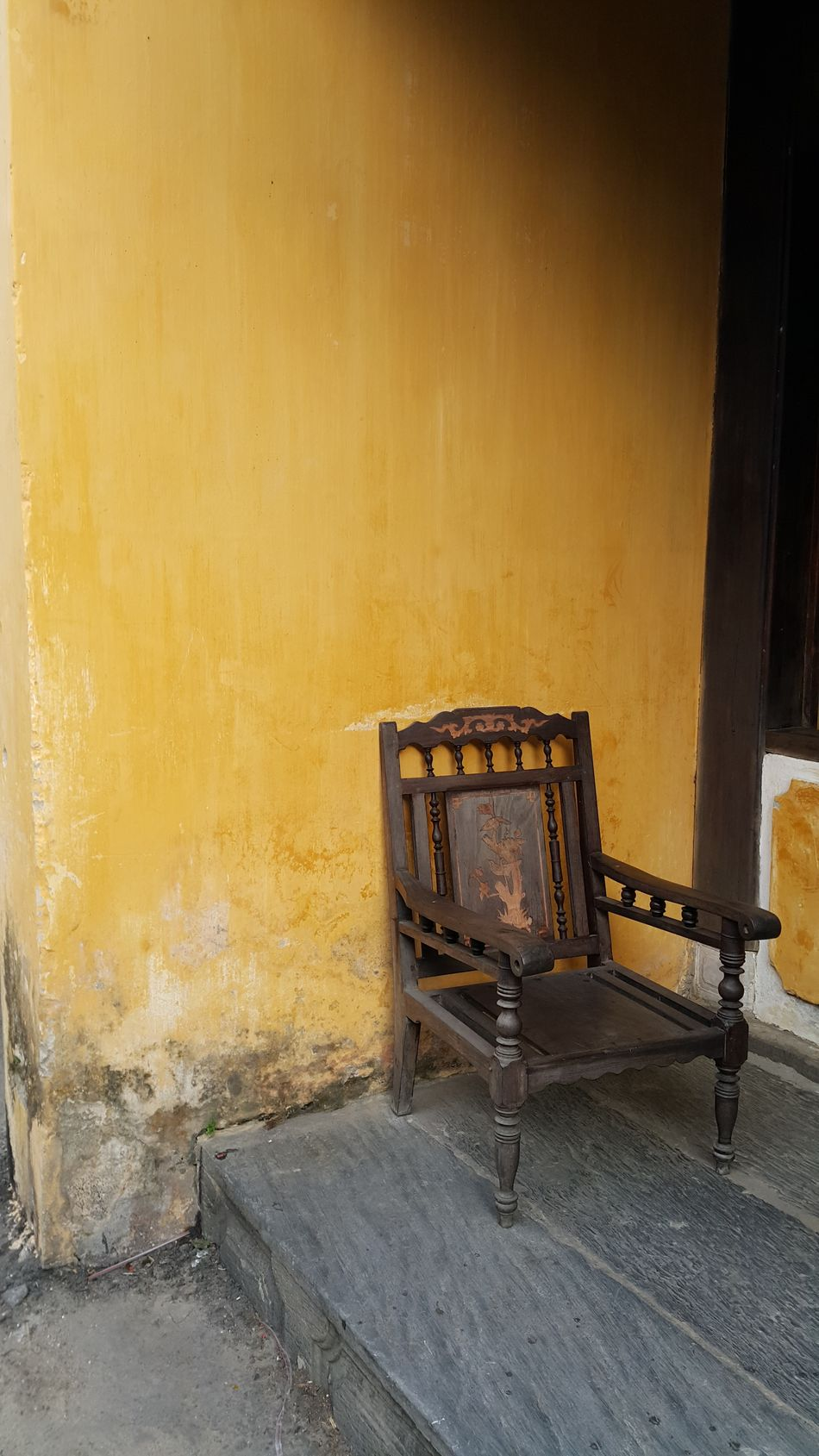 One seat isolated on a yellow wall background Solitude Solitary Moments Alone One Empty Empty Seat Seat Armchair Yellow Wall Yellow Background No People Vietnam Ancient Calm Relax Time Past