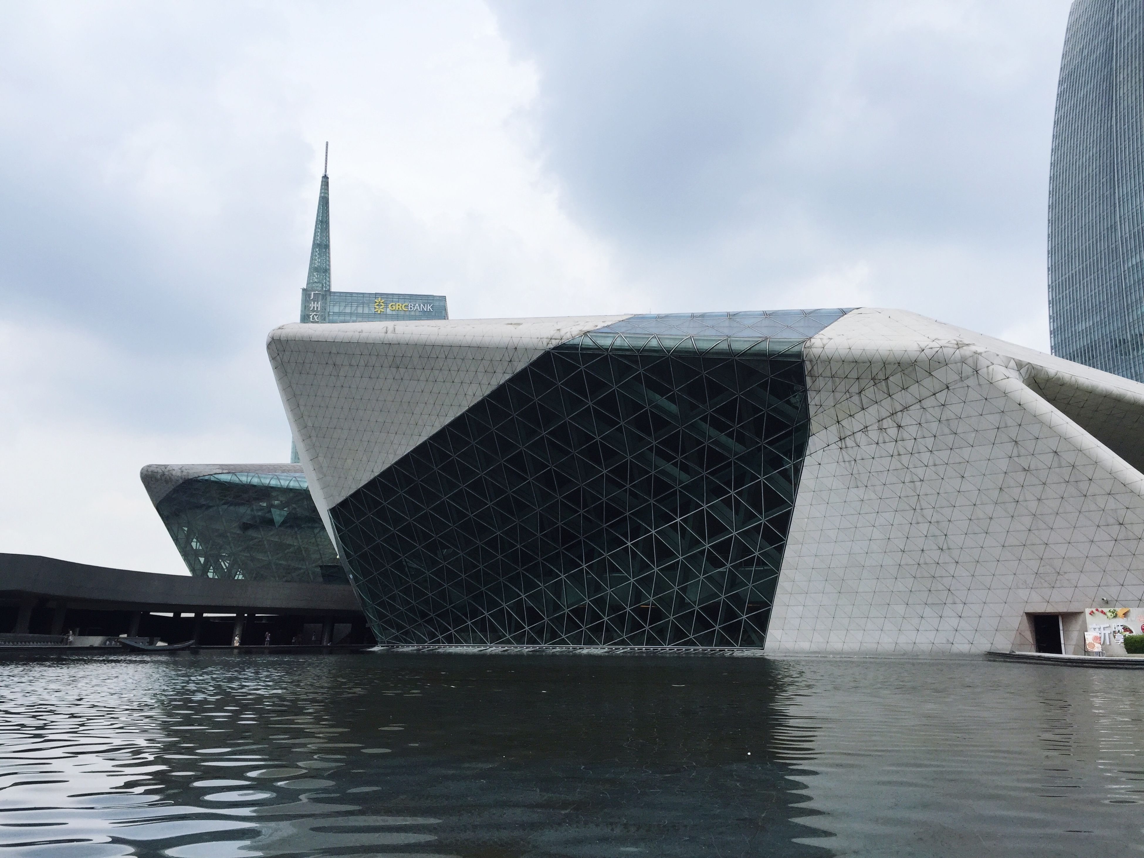 building exterior, architecture, built structure, water, sky, waterfront, cloud - sky, church, rippled, tower, river, reflection, day, city, religion, place of worship, cloudy, cloud, outdoors