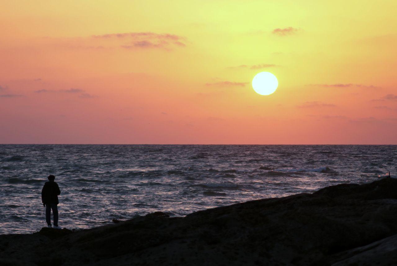 SUNSET Sea Sunset Beach Horizon Over Water Outdoors One Person Sky Karachi EyeEm Hello World Karachi Seaport TakeoverContrast Water Nature Natgeotravel Tranquil Scene Coastline Beachphotography Beauty In Nature Scenics Film Relaxing
