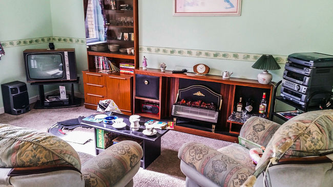 90's  Living Room Television Hi-Fi Sofa Electric Fire Carpet Clock Shelves Fireplace Unit Sideboard Coffee Table Games Toys Speaker Bookss Radio Drink Alcohol Wallpaper Border Ornaments Lamp Lampshade