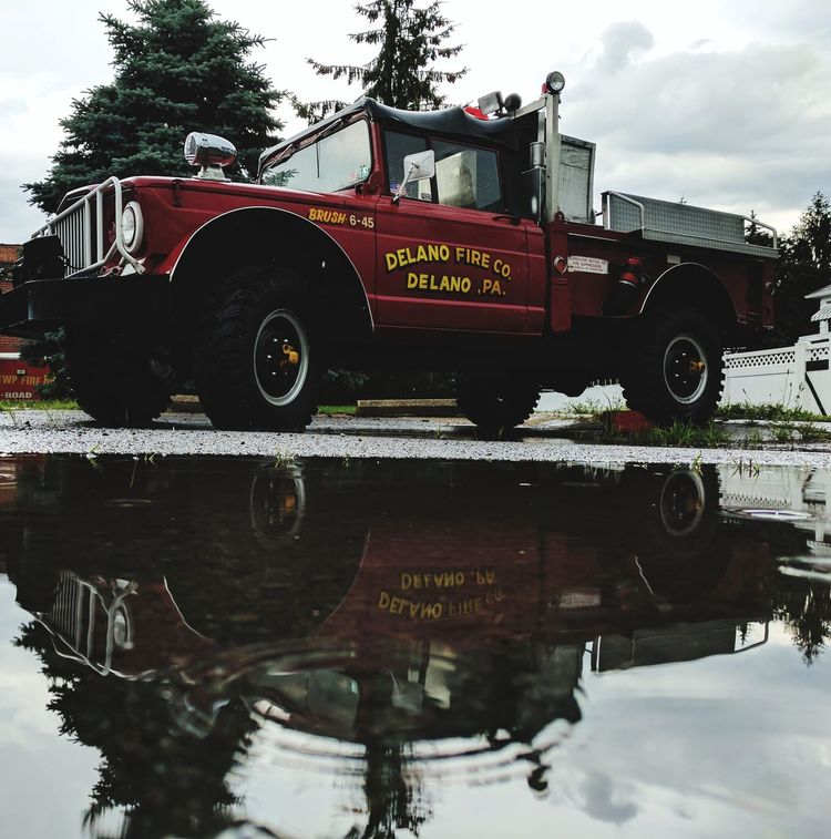 Firefighter Fire Engine Rescue Water Outdoors Sky Day Truck Rain Reflections Perspective RainDrop Droptop  Politics And GovernmentAccidents And Disasters Flood People No People Live Laugh Love EyeEmNewHere