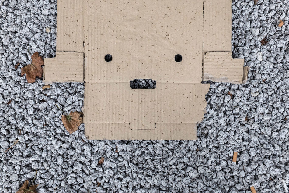 Cardboard face in Warsaw, Poland Abstract Cardboard Cardboard Box Day Face Faces In Places Facial Expression Found Art Fun Humour Humourous No People Outdoors Poland Portrait Rubbish Stones Street Photography Streetphoto Streetphotography Surprised Textured  Warsaw
