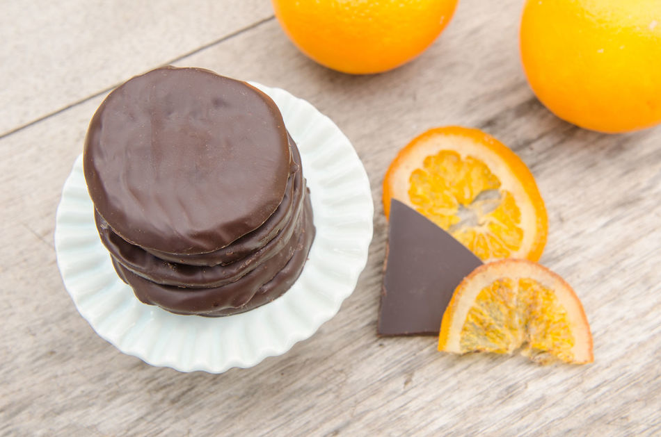 Candied orange slices covered with chocolate on wood table, nature background Bitted Candied Candied Fruit Chocolate Close-up Confection Dessert Food Fruit Gourmet Horizontal Nature No People Orange Orange - Fruit Piece Sliced Slices Sugar Sweet Sweet Food Table Wood - Material